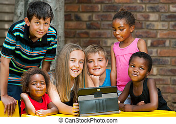 Bunch of kids playing on tablet.