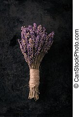 Bunch of lavender flower on black tray