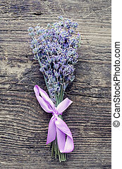 Bunch of lavender flowers on a wooden background