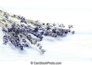 Bunch of lavender flowers on white wooden background