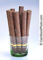Bunch of long cigars in a glass