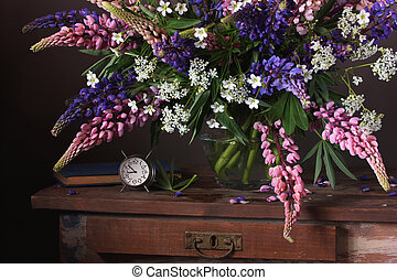 Bunch of lupins. Still life with flowers in a vase.