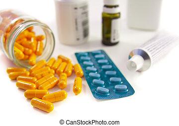 bunch of pills - pills assortment on white bakcground