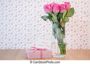 Bunch of pink roses in vase with p