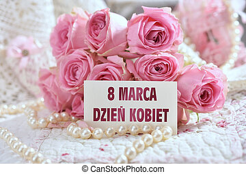 bunch of pink roses with greeting card for Women Day in Poland