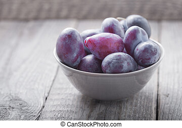 Bunch of Plums on a wooden table