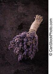 Bunch of purple lavender flower on black tray