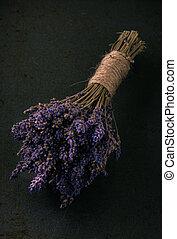 Bunch of purple lavender flower on dark tray