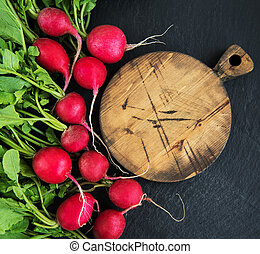 Bunch of radish with empty board