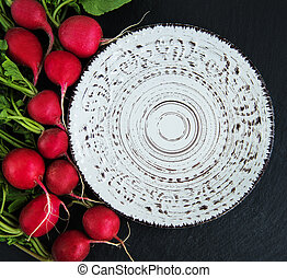 Bunch of radish with empty plate