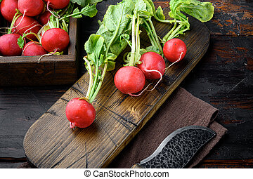 Bunch of radishes. Freshly harvested, purple colorful radish. Growing radish. Growing vegetables. Healthy food background, on old dark wooden table background