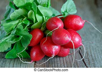 Bunch of radishes on wooden background