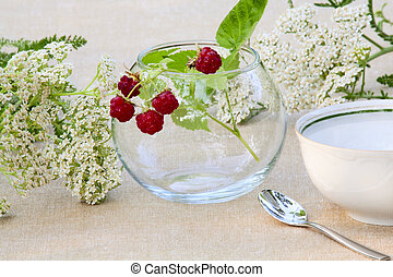 Bunch of raspberries in a glass bowl