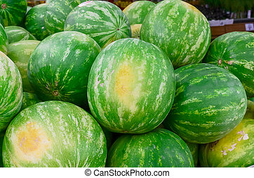 Bunch of raw whole watermelons background at farmer market in America