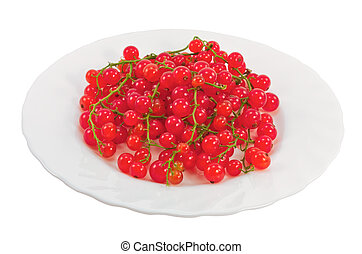 Bunch of red currants on a plate