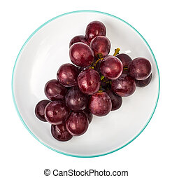 Bunch of red grapes on plate
