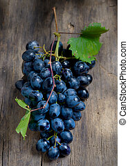 Bunch of red grapes on wooden background