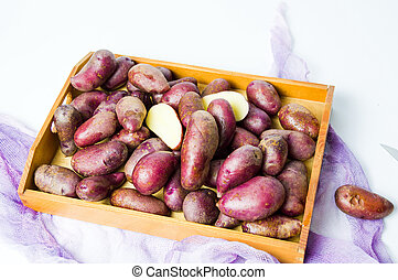 Bunch of red potatoes in a wooden box