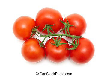 bunch of ripe red tomatoes closeup on a white background