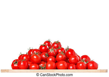 Bunch of ripe red tomatoes on a white