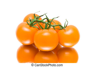 bunch of ripe tomatoes on a white background with reflection