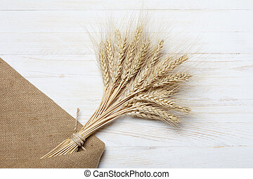 Bunch of ripe wheat on wooden table