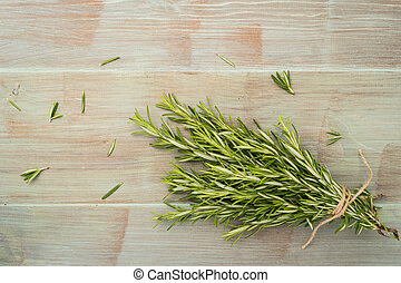 Bunch of rosemary on old wooden board