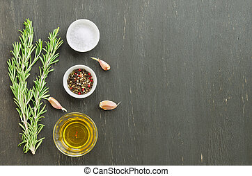 Bunch of rosemary with garlic, olive oil and spices