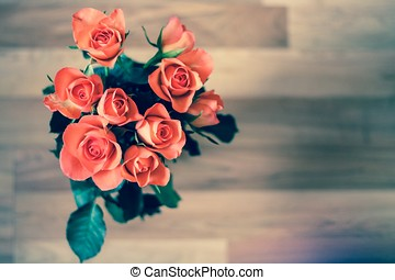 Bunch of roses red flowers above wooden floor isolated leaves romantic valentines day couple