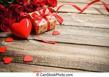 Bunch of roses with a gift box and red heart