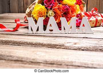 Bunch of roses with a gift box and word Mama
