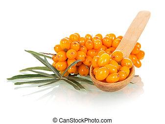 Bunch of sea buckthorn and wooden spoon with berries it is ...