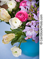 bunch of spring flowers - bunch of freesias, tulips, ...