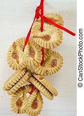 Bunch of tea cookies on white - Bunch of tea cookies tied ...