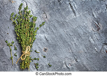 Bunch of Thyme on Dark Slate Top View