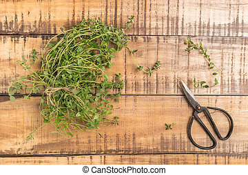Bunch of thyme on old wooden board