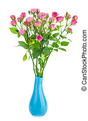 Bunch of tiny pink roses in a blue ceramic vase