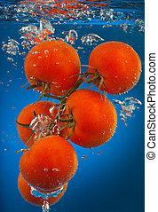 Bunch of tomatoes underwater