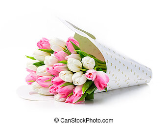 Bunch of tulips in paper bag over white