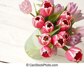 Bunch of tulips on wood