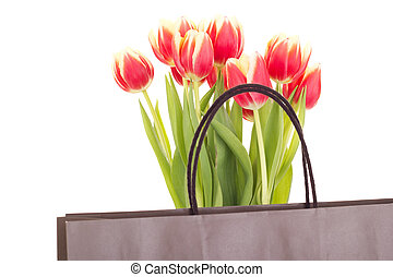 Bunch of tulips with bag