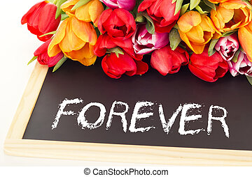 Bunch of tulips with blackboard: forever