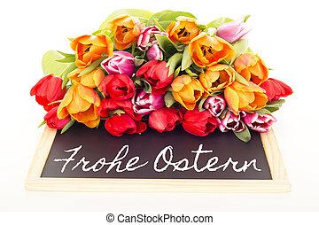Bunch of tulips with blackboard: happy easter