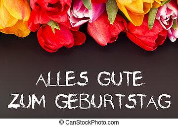 Bunch of tulips with blackboard: happy birthday