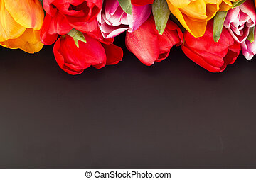 Bunch of tulips with blackboard