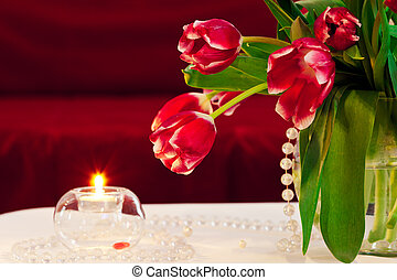 Bunch of tulips with candle - indoor shot