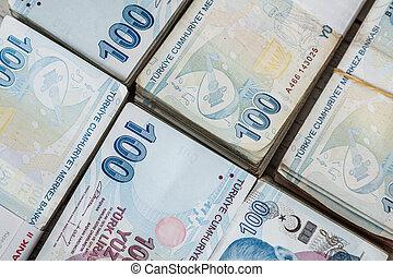 Bunch of Turkish Lira over white wooden background