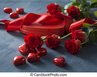 Bunch of Valentines Day red roses and box with red hearts