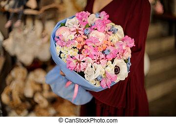 Bunch of various flowers in girl's hands