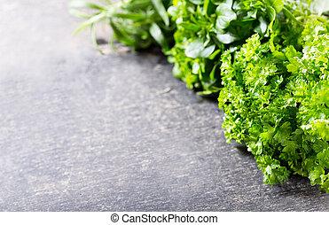 garden fresh herbs on dark table